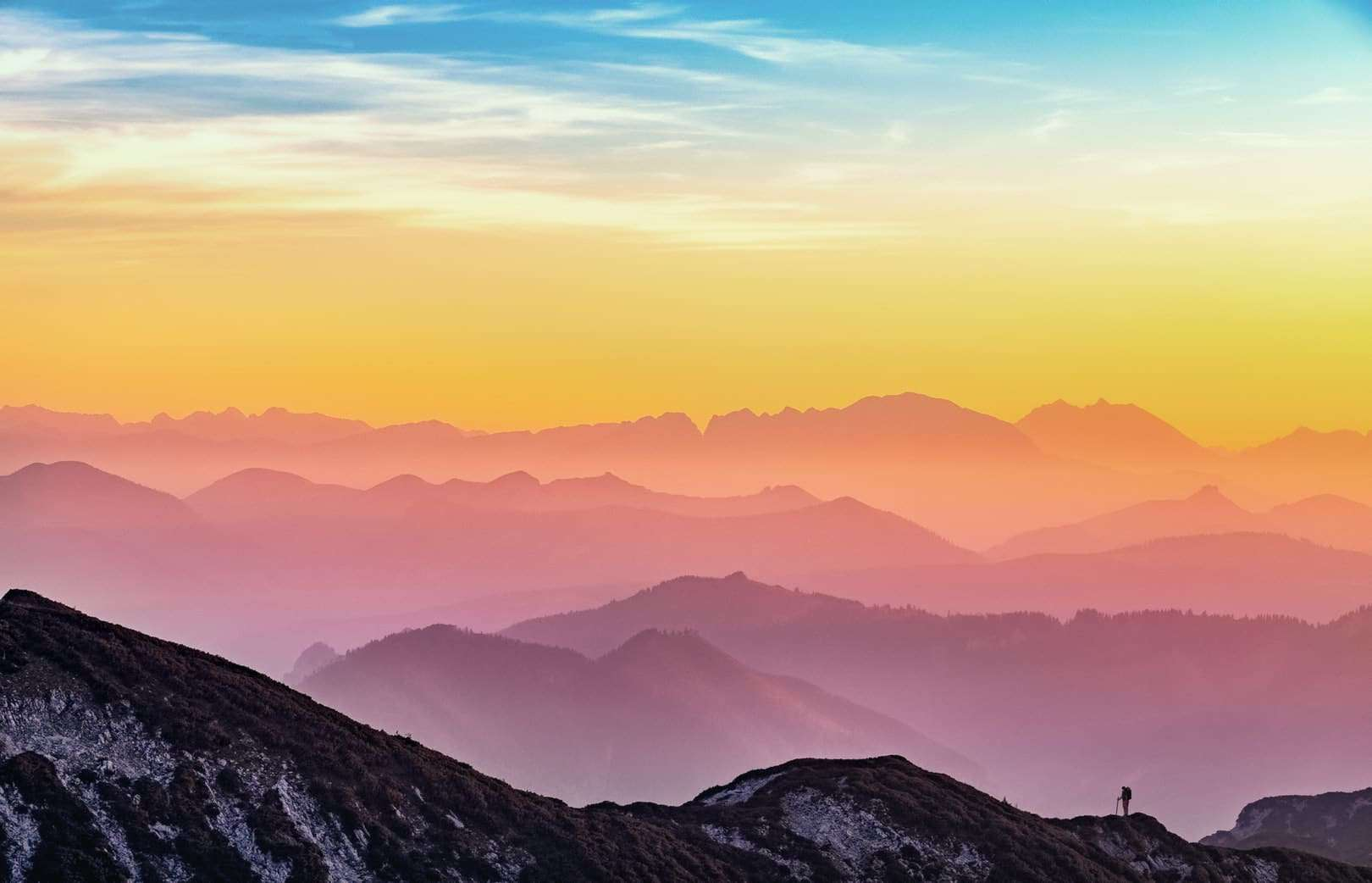 A rainbow of colors on a mountain range at sunrise